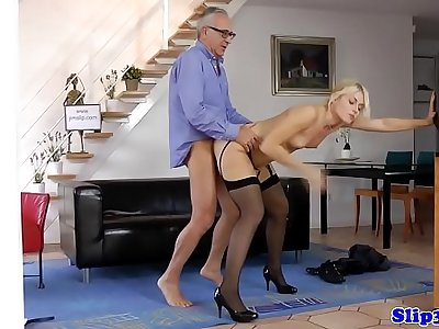 Young blonde sucks old mans cock at home